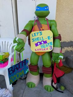 Used the Ninja turtle we had bought from Target and added a few signs.