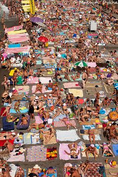Crowded places .Oh my god. Sudak beach. Crimea, Ukraine  This reminds me of HB by the pier