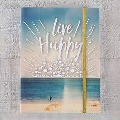 """This journal features the inspiring sentiment, """"Live Happy"""" with a beach scene background, lined paper, an inside pocket and gold elastic closure. Live Happy, Natural Life, Office Supplies, Notebook, Frame, Decor, Picture Frame, Decoration, Natural Living"""
