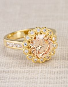 Relieve the stress of a long day with this champagne color ring. No glass required. l 5.60ctw Champagne And White Diamond Simulant 18k Yellow Gold Over Sterling Silver Halo Ring l Spring Accessories