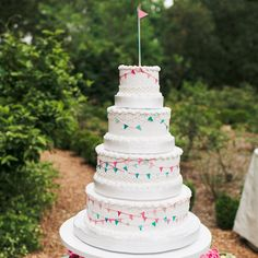 Colorful Pennant Flag Cake - photo by: Our Labor Of Love Event Planning: Ashley Baber Weddings Location: Barnsley Gardens Resort Cake: Classic Cheesecakes & Cakes