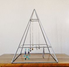 Welded Pyramid Jewelry Display in Silver on Etsy, a global handmade and vintage marketplace.