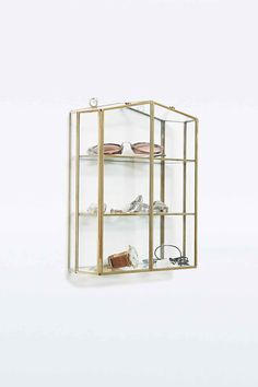 house jewellery stand in gold