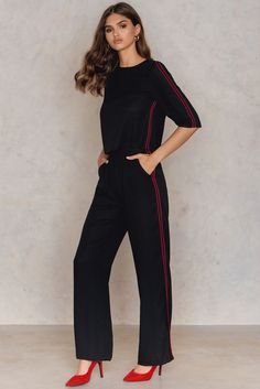 It's all in the details, babe. The Striped Wide Pants by NA-KD Trend comes in black and features sheer lightweight material, a zipper and open bar closure with inner buttons, wide legs, side stripes, two mock pockets on the back, and is unlined. Pair this baby with a simple white singlet and some sneakers for a cool, sporty look!