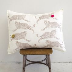 Whimsical. But I could never justify spending $124 for a pillow made of linen and polyester filling. GRAND CUSHiON - LEOPARDS ON MiLKY WHiTE