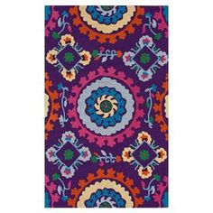 Hand-tufted rug with a multicolor suzani motif.   Product: RugConstruction Material: 100% PolyesterColor: Purple and multiFeatures: Hand-tufted Note: Please be aware that actual colors may vary from those shown on your screen. Accent rugs may also not show the entire pattern that the corresponding area rugs have.Cleaning and Care: Spot treat with a mild detergent and water. Professional cleaning is recommended if necessary.