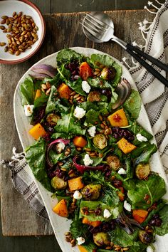 This hearty salad is brimming with the flavors of fall with ingredients such as pumpkin seeds, brussels sprouts, cranberries, and dark, leafy greens. The salad here is tossed with baby kale, which is much more tender and easier to eat uncooked, which makes it a perfect green to use for a salad like this.#friendsgiving #friendsgivingrecipes #thanksgiving #recipes #myrecipes