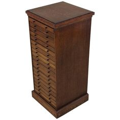 Edwardian English Oak Collectors Chest | From a unique collection of antique and modern cabinets at https://www.1stdibs.com/furniture/storage-case-pieces/cabinets/