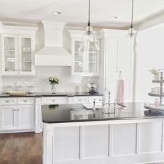 The kitchen of is a study in classic design - bright white cabinetry dark counter tops wood floors and airy lighting all contribute to a beautifully crafted space. by potterybarn Kitchen Design Open, Outdoor Kitchen Design, Kitchen Layout, Kitchen Designs, Open Kitchen, Cocina Shabby Chic, Shabby Chic Kitchen, Kitchen Paint, Kitchen Decor