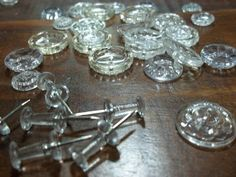 Candy dish/cake plate from clear buttons and pushpins. Would make a great addition to a dollhouse or Barbie set.