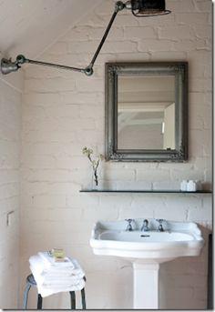 Jielde mounted above bathroom vanity Image Via: Hyphen Interiors.