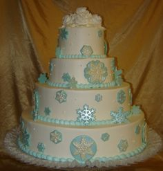 This cake was decorated with winter in mind but also the color Blue.  The customer requested beautiful fondant snowflakes white and blue.  The two toned  colors truly make it unique.