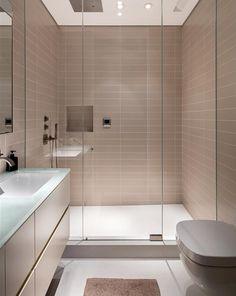 This ensuite bathroom is serene, boasting a floating vanity, steam shower, Sonos speakers, and Caesarstone flooring. Loft Bathroom, Guest Bathrooms, Bathroom Layout, Modern Bathroom Design, Bathroom Interior Design, Minimalist Small Bathrooms, Ideas Baños, Master Bath Shower, Soho Loft