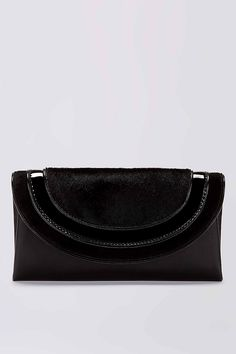 Perfect for after dark, this sleek envelope clutch is finished in fine calf hair and patent leather. It has a hidden back slit pocket and magnetic snap closure.