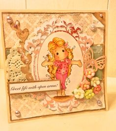 Tip toe Tilda! Beautifull Magnolia image made into a shabby chic card, featuring lots of cute embellishments
