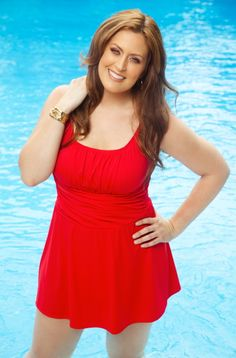 Sensationally slimming plus size swim dress. Extra firming power mesh lining makes swimsuit universally flattering for full figured women. You'll be over the moon with the Always For Me Plus Size Sw