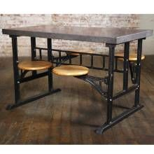 Manufactured in the early 20th century, this swing-out breakfast table features a metal top, cast-iron base and wood seats. It originally was used in the dining hall of an institutional building.
