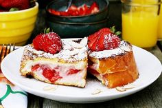 Strawberry Stuffed French Toast: 1 loaf French bread  3 T jelly, jam, or fresh fruit  4 oz. cream cheese at room temperature  Combine the fruit and cream cheese and stuff into pockets in your French bread. Combine 2 eggs,1 T Cinnamon and  ½ c milk and dip your stuffed toast, then brown in butter on a skillet and top with butter and syrup.