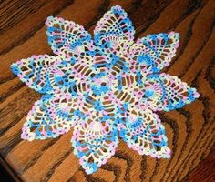 Our petite pineapple spring doily is fun to work up in a jiffy!   Did I mention it's free?