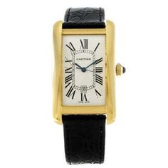 CARTIER - an 18ct yellow gold Tank Americaine wrist watch.