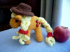 Orange Pony - Applejack!  So adorable!  She also has patterns for the other ponies.