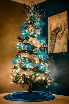 Peacock Christmas tree for next year Peacock Christmas Tree, Turquoise Christmas, Beautiful Christmas Trees, Holiday Tree, Blue Christmas, Xmas Tree, Winter Christmas, Christmas Themes, Christmas Tree Decorations