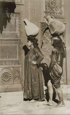 2 Egyptian Females Carrying water  cairo 1900 .