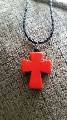 Check out this item in my Etsy shop https://www.etsy.com/listing/463865277/orange-fiesta-cross-pendant