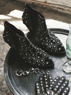 After Dark Boot | These pull-on ankle boots are diamond dazzlers. Bejeweled to the max, these black suede shoes have a western-inspired shape and star quality. Pointy toes and wood heels with a purpose. Elastic gussets for easy on-off.   *By Jeffrey Campbell + Free People