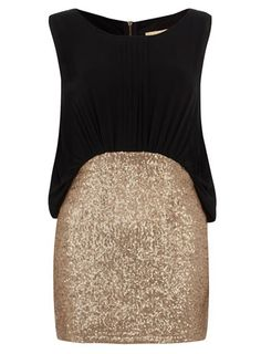 New Years outfit - Black flowy top tucked into sparkley skirt with black tights and heels.