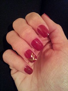 Festive red nails with gold nail art!