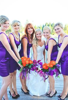 Purple and Orange Wedding perfect. me with purple and orange flowers and the girls in purple dresses with orange flowers.