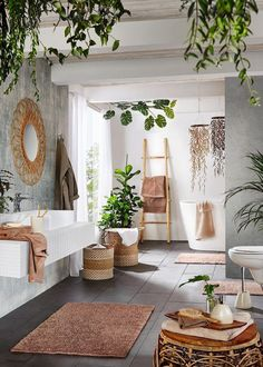 boho Bathroom Decor a contemporary meets boho space with potted greenery, baskets, rattan furniture, a wicker mirror and a ladder Bohemian Bathroom, Bohemian Bedroom Decor, Tropical Bathroom Decor, Green Bathroom Decor, Wooden Bathroom Accessories, Taupe Bathroom, Boho Chic Living Room, Master Bathroom, Bathroom Modern