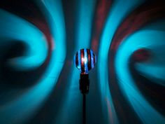 The ORIGINAL Hand-Painted Turquoise Spiral Mood-Light Bulb 4 Color Therapy, Night Lights, Parties, Mood Lighting from MoodLights. Saved to Pretty Lights. Light Bulb Art, Low Energy Light Bulbs, Painted Light Bulbs, Mood Light, Light Blue Rooms, Dorm Lighting, Solar Path Lights, Kids Lamps, White Lamp Shade