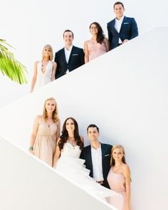 A staircase at the hotel offered a great backdrop for the couple and their wedding party to pose for a picture.