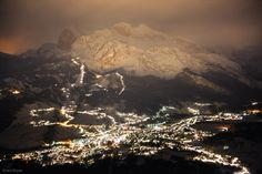 """""""Nighttime lights of Cortina d' Ampezzo illuminate the mountains above town on a snowy November night.  Photo © by Jack Brauer."""""""