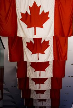 Canadian flags at the Toronto Stock Exchange | by Darren // DA Creative Photography, via Flickr