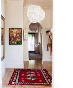 great use of art in this Australian home; from the Design Files -- also: the RUG!