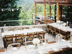 I couldn't think of a better way to kick off New Years Eve than with this charming gold and white wedding in Lake Lure, NC. Gina and Chad said their vows overlooking the pristine blue waters of Lake Lure nestled within the mountains of North Carolina. An outdoor reception awaited their guests including a cozy...