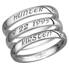 stackable rings, with a name and date of birth on each. From: Carved Creations   ---  (they also have a family tree necklace and other items)