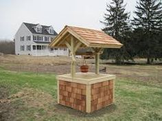wishing well covers well pump Wooden Storage Buildings, Well Pump Cover, Septic Tank Covers, Japanese Fence, Canada House, Pump House, Water Well, Outdoor Furniture Sets, Outdoor Decor