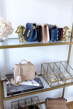 Glass and brass closet shelves: http://www.stylemepretty.com/living/2016/11/28/this-is-what-closet-dreams-are-made-of/ Photography: Jessica Alexander - http://jessicaalexanderphotography.com/