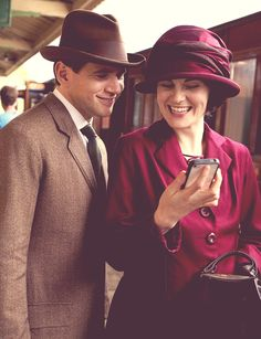 Downton behind the scenes. It's so weird to watch them all dressed up in their early 1900's attire playing on their smartphones.