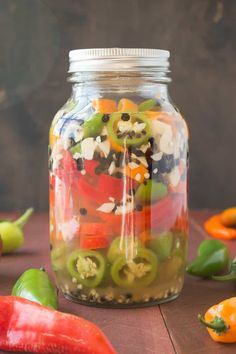 How to Pickle Chili Peppers - A Guide - Learn how to pickle chili peppers straight from the garden. It is very easy to do, and the peppers will last several weeks or months. It's a great way to preserve your chili peppers. Hot Sauce Recipes, Spicy Recipes, Chili Recipes, Pepper Recipes, Tuna Recipes, Pickled Pepper Recipe, Pickled Sweet Peppers, Homemade Ham, Homemade Pickles