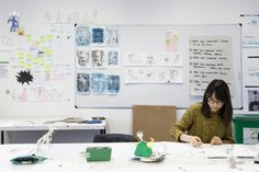 Student working on her illustrations, in the studio.  Photograph: Spine Photographic