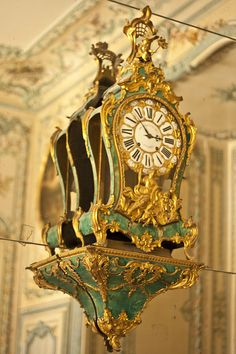 A fabulously opulent clock in the Queens' Apartments at the Palace of Versailles