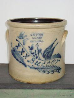 Stoneware Butter Crock...C. M. Evans, Grocer imprinted on the crock.