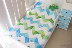 blue green zig zag... i like that i see some of the very hungry caterpillar fabrics in there