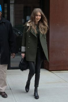 Model Gigi Hadid steps out in New York City, New York on February 5, 2017. She wore a long green coat, and skin tight black pants while she was out and about.