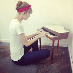 Taylor Swift playing tiny piano